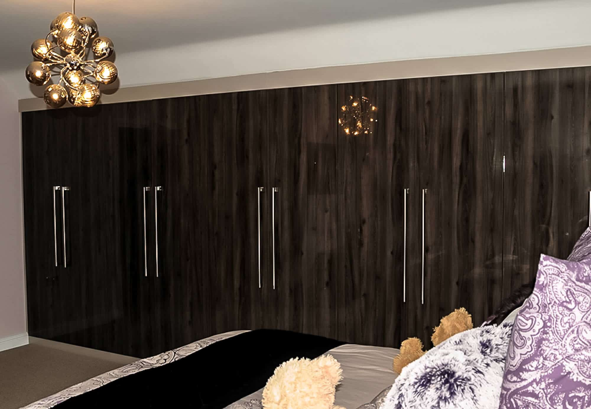 Darkwood bedroom wardrobes with chrome handles