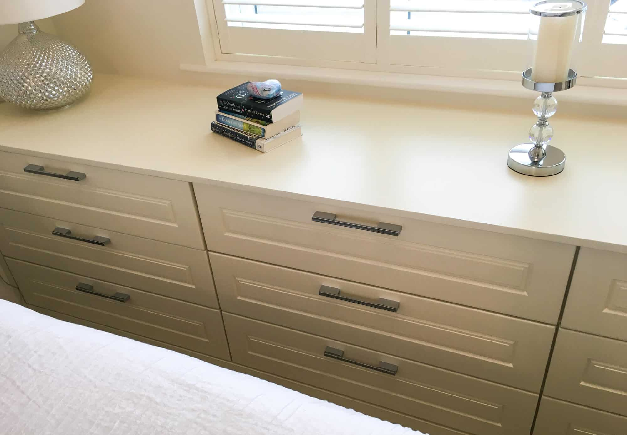 Modern bedroom design showing contemporary drawers with chrome handles