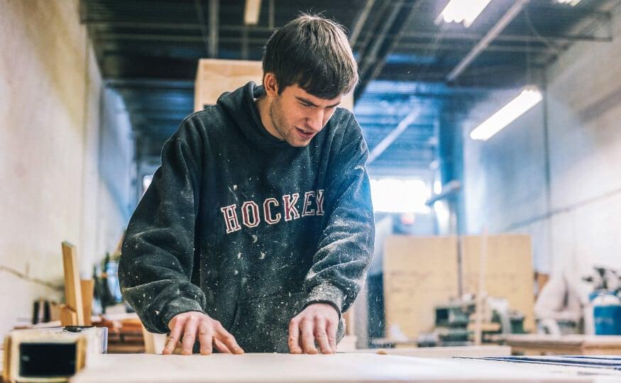 Design & Manufacture video still - Joiner making a kitchen cabinet carcass