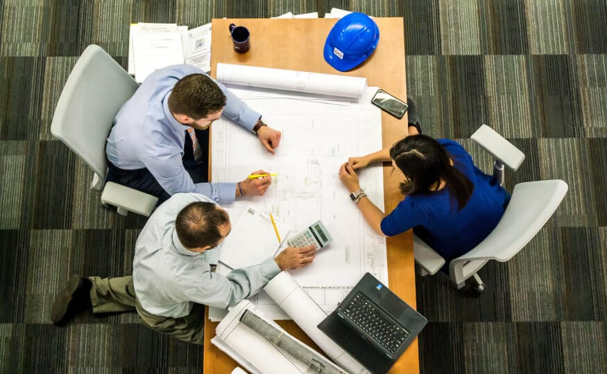Design and project management team working around a desk
