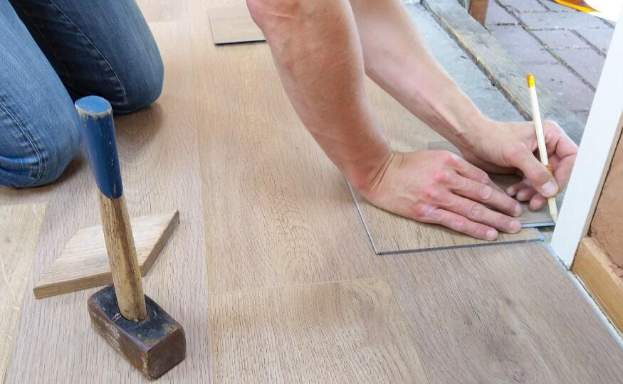 Flooring fitter working