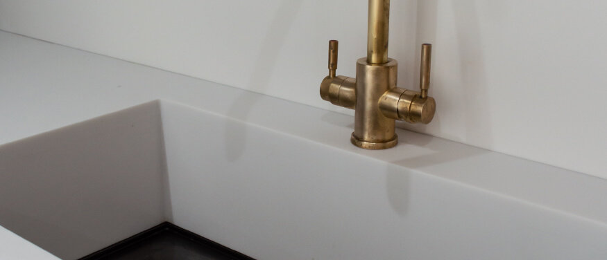 Acrylic Kitchen Counter Close Up with Rustic Brass Sink MIxer