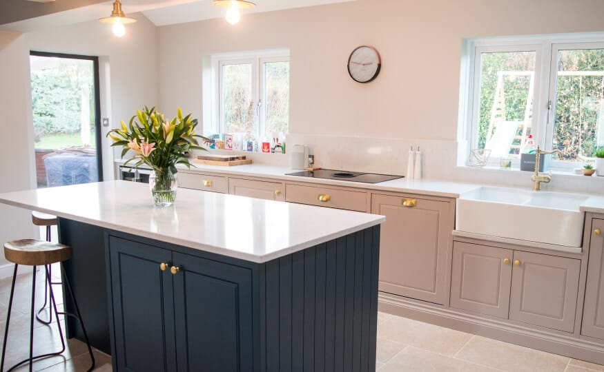 Kitchen with central island countertop and brass fixtures